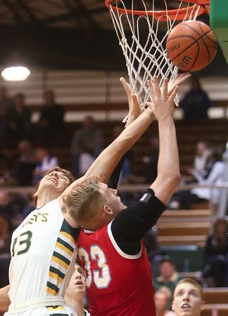 1-8-16<br /> Eastern vs Maconaquah boys basketball<br /> Eastern's Braden Evans and Maconaquah's Wyatt Hughes go after a rebound.<br /> Kelly Lafferty Gerber | Kokomo Tribune