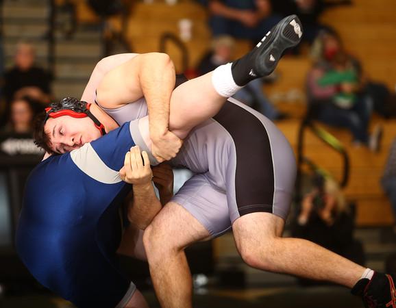 1-20-16<br /> WHS wrestling<br /> Western's Josh Hozey and Central Catholic's Tommy Devine in the 285.<br /> Kelly Lafferty Gerber | Kokomo Tribune