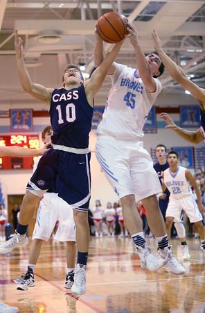 1-29-16   Mac vs Cass Bbball  <br /> Cass' Alec Eurit and Maconaquah's Blake May<br /> Kelly Lafferty Gerber   Kokomo Tribune