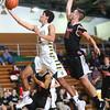 1-28-16 EHS boys basketball<br /> Eastern's Trey Thomas and Sheridan's Tommy Glidden<br /> Kelly Lafferty Gerber | Kokomo Tribune