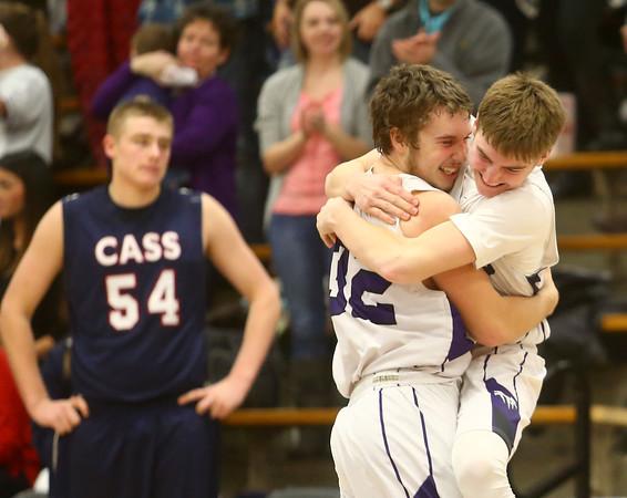 1-22-16<br /> Northwestern vs Cass boys basketball<br /> Noah Dowden who sunk the game winning shot hugs his teammate Collin Hodson after the Tigers victory.<br /> Kelly Lafferty Gerber | Kokomo Tribune