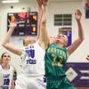 1-5-16<br /> Northwestern vs Eastern girls basketball<br /> Northwestern's Michelle Hunkeler and Eastern's Ashlynn Hochstedler go after a rebound.<br /> Kelly Lafferty Gerber | Kokomo Tribune