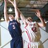 1-28-16 Taylor boys basketball<br /> Tri County's Ben Cook and Taylor's Donovan Renbarger go for a rebound.<br /> Kelly Lafferty Gerber | Kokomo Tribune