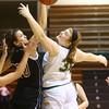 1-9-16<br /> Eastern vs Taylor girls basketball<br /> Taylor's Shaelah Eliason and Eastern's Hailey Holliday go after a rebound.<br /> Kelly Lafferty Gerber | Kokomo Tribune