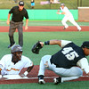 7-30-16<br /> Jackrabbits vs Cavemen<br /> Lance Mays slides safely to third as Cavemen's Romero Harris misses the throw to third.<br /> Kelly Lafferty Gerber | Kokomo Tribune