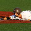 7-30-16<br /> Jackrabbits vs Cavemen<br /> Chris Amato slides back to third.<br /> Kelly Lafferty Gerber | Kokomo Tribune