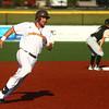 7-30-16<br /> Jackrabbits vs Cavemen<br /> Mitch Stoltzfus runs to third base.<br /> Kelly Lafferty Gerber | Kokomo Tribune
