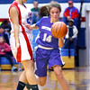 The city county 7th grade  basketball tournament between Kokomo and Northwestern at Memorial Gym on March 21, 2016. Kokomo's Jannessa Reese putting pressure on Northwestern's Hope Braun in the final seconds of the 7th grade championship getting called for a foul.<br /> Tim Bath | Kokomo Tribune