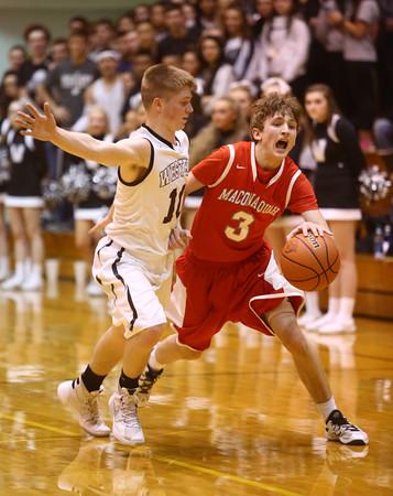 3-4-16<br /> Maconaquah vs Western boys sectional bball<br /> Maconaquah's Chander Pitts and Western's Josh Beeler<br /> Kelly Lafferty Gerber   Kokomo Tribune