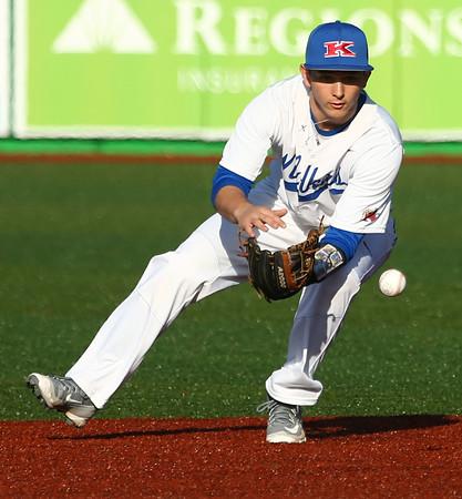 3-29-16<br /> Kokomo vs Huntington North baseball<br /> Kokomo's Noah Hurlock picks up the ball after it bounces and throws it to first.<br /> Kelly Lafferty Gerber | Kokomo Tribune