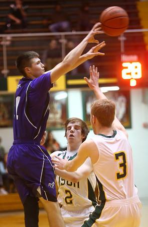 3-4-16<br /> Northwestern boys sectional bball<br /> Northwestern's Austin Miller passes over Benton Central.<br /> Kelly Lafferty Gerber | Kokomo Tribune