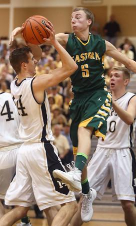 3-12-16<br /> Eastern Boys basketball regional semifinal<br /> Eastern's Tristen Moyers tries to take the ball from Lapel's Jon Ross Richardson.<br /> Kelly Lafferty Gerber | Kokomo Tribune