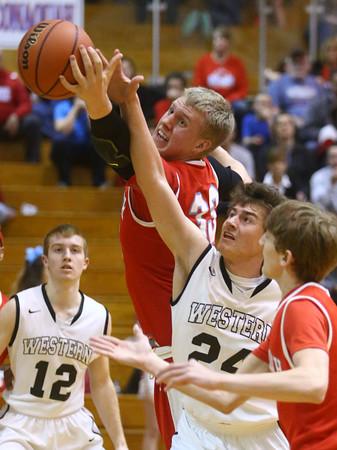 3-4-16<br /> Maconaquah vs Western boys sectional bball<br /> Maconaquah's Wyatt Hughes and Western's Brodee Lipinski go after a rebound.<br /> Kelly Lafferty Gerber   Kokomo Tribune