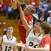 3-4-16<br /> Maconaquah vs Western boys sectional bball<br /> Maconaquah's Wyatt Hughes and Western's Brodee Lipinski go after a rebound.<br /> Kelly Lafferty Gerber | Kokomo Tribune