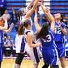 The city county 8th grade  basketball tournament between Kokomo and Northwestern at Memorial Gym on March 21, 2016. Northwestern's Kendall Bostic reaches over the Kokomo players for a rebound.<br /> Tim Bath | Kokomo Tribune