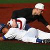 3-29-16<br /> Kokomo vs Huntington North baseball<br /> Kokomo's Perry McCullum safely slides back to third base before Huntington North's Hunter Welch gets him out.<br /> Kelly Lafferty Gerber | Kokomo Tribune