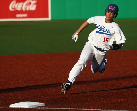 3-29-16<br /> Kokomo vs Huntington North baseball<br /> Kokomo's Perry McCullum rounds third base.<br /> Kelly Lafferty Gerber | Kokomo Tribune
