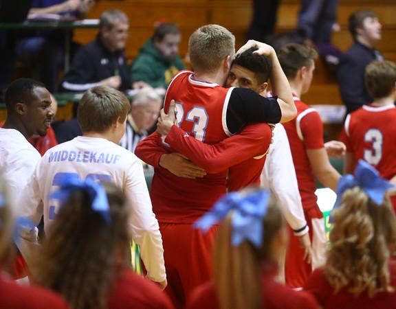 3-4-16<br /> Maconaquah vs Western boys sectional bball<br /> Wyatt Hughes and Brayden Marley hug after Maconaquah wins.<br /> Kelly Lafferty Gerber   Kokomo Tribune