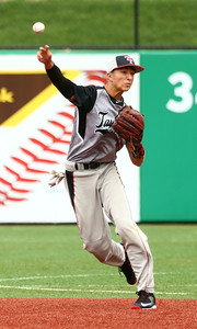 5-7-16 Taylor vs Tri Central baseball Cole Braun throws the ball to first. Kelly Lafferty Gerber | Kokomo Tribune