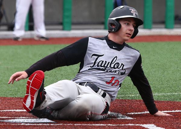 5-7-16 Taylor vs Tri Central baseball Justin Moody slides to home and scores a run. Kelly Lafferty Gerber | Kokomo Tribune