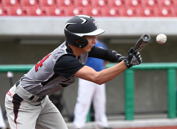 5-7-16 Taylor vs Tri Central baseball Bailey Owens bunts. Kelly Lafferty Gerber | Kokomo Tribune