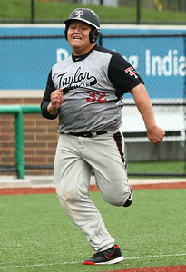 5-7-16 Taylor vs Tri Central baseball Anthony Ramirez runs to home and scores a run for the Titans. Kelly Lafferty Gerber | Kokomo Tribune
