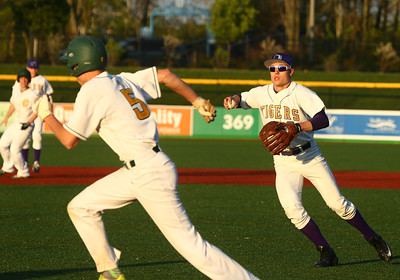 5-5-16 Eastern vs Northwestern baseball Northwestern's Ethan Breisch tries to chase down Eastern's Tristen Moyers, but Moyers beats him back to third. Moyers went on to score the eighth run in the extra inning, tying the game with the Tigers. Kelly Lafferty Gerber | Kokomo Tribune