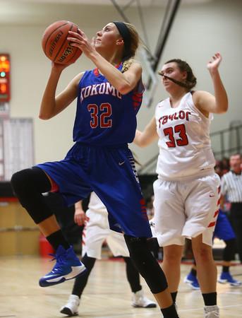 11-9-16<br /> Taylor vs Kokomo girls basketball<br /> Kokomo's Brittany Barnard goes to the basket.<br /> Kelly Lafferty Gerber | Kokomo Tribune