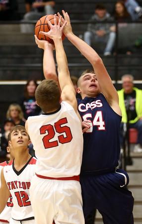 11-26-16<br /> Taylor vs Cass boys basketball<br /> Cass' Cohen Nies shoots.<br /> Kelly Lafferty Gerber | Kokomo Tribune