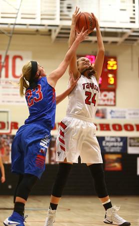 11-9-16<br /> Taylor vs Kokomo girls basketball<br /> Taylor's Brooke McGuire grabs the rebound.<br /> Kelly Lafferty Gerber | Kokomo Tribune