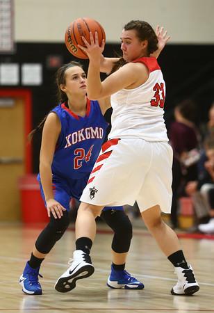 11-9-16<br /> Taylor vs Kokomo girls basketball<br /> Olivia Branch plays defense on Taylor's Lanee Butzin.<br /> Kelly Lafferty Gerber | Kokomo Tribune
