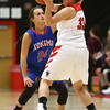 11-9-16<br /> Taylor vs Kokomo girls basketball<br /> Olivia Branch plays defense on Taylor's Lanee Butzin.<br /> Kelly Lafferty Gerber | Kokomo Tribune