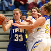 11-10-16<br /> Tri Central vs Tipton girls basketball<br /> Tipton's Lauren Shively tries to grab a loose ball before Tri Central can.<br /> Kelly Lafferty Gerber | Kokomo Tribune