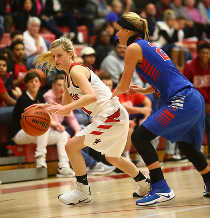 11-9-16<br /> Taylor vs Kokomo girls basketball<br /> Taylor's Jade Rhoades dribbles toward the basket.<br /> Kelly Lafferty Gerber | Kokomo Tribune