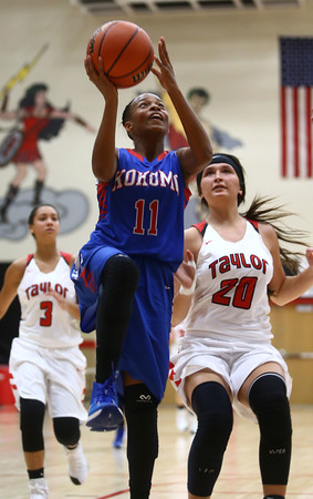 11-9-16<br /> Taylor vs Kokomo girls basketball<br /> Kokomo's Tionna Brown goes for a lay up.<br /> Kelly Lafferty Gerber | Kokomo Tribune