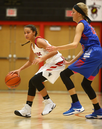 11-9-16<br /> Taylor vs Kokomo girls basketball<br /> Taylor's Asia Stabler tries to get around Kokomo's Brittany Barnard.<br /> Kelly Lafferty Gerber | Kokomo Tribune