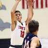 11-26-16<br /> Taylor vs Cass boys basketball<br /> Taylor's Cole Braun goes up for a shot.<br /> Kelly Lafferty Gerber | Kokomo Tribune
