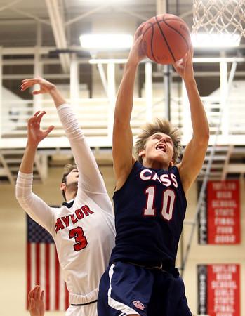 11-26-16<br /> Taylor vs Cass boys basketball<br /> Cass' Alec Eurit grabs a rebound.<br /> Kelly Lafferty Gerber   Kokomo Tribune