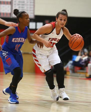 11-9-16<br /> Taylor vs Kokomo girls basketball<br /> Taylor's Brooklynn Campbell tries to get out of Tionna Brown's defense.<br /> Kelly Lafferty Gerber | Kokomo Tribune
