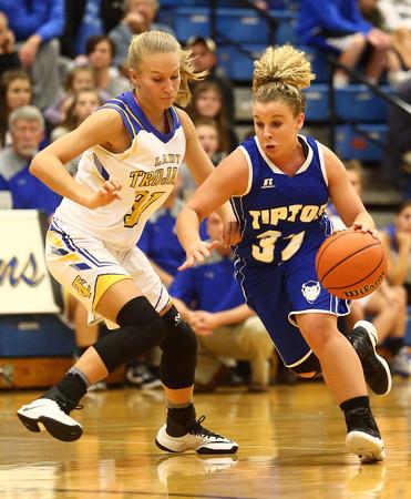 11-10-16<br /> Tri Central vs Tipton girls basketball<br /> Tipton's Taylor Robison dribbles around Tri Central's Emily Richard.<br /> Kelly Lafferty Gerber   Kokomo Tribune