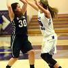 11-22-16<br /> Northwestern vs Western girls basketball<br /> Western's Makenzie Burton looks around Northwestern's defense for a pass.<br /> Kelly Lafferty Gerber | Kokomo Tribune