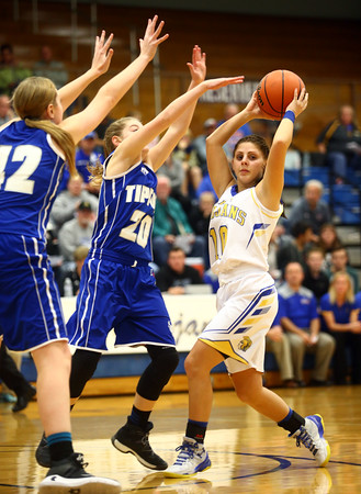 11-10-16<br /> Tri Central vs Tipton girls basketball<br /> Tri Central's Kinsey Leininger looks for a pass around Tipton's defense.<br /> Kelly Lafferty Gerber | Kokomo Tribune