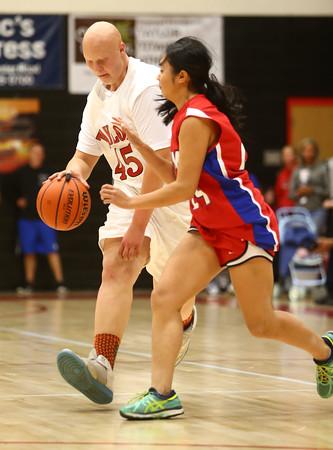 11-9-16<br /> Unified Basketball<br /> Taylor's Hunter Ford tries to get around Kokomo Lana Pham's defense.<br /> Kelly Lafferty Gerber | Kokomo Tribune