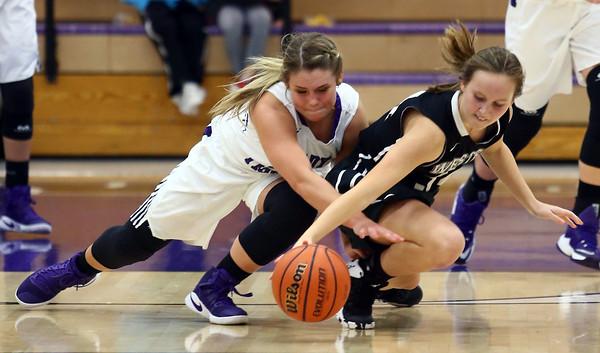 11-22-16<br /> Northwestern vs Western girls basketball<br /> NW's Morgan Mercer and Western's Makayla Calloway go after a loose ball.<br /> Kelly Lafferty Gerber | Kokomo Tribune