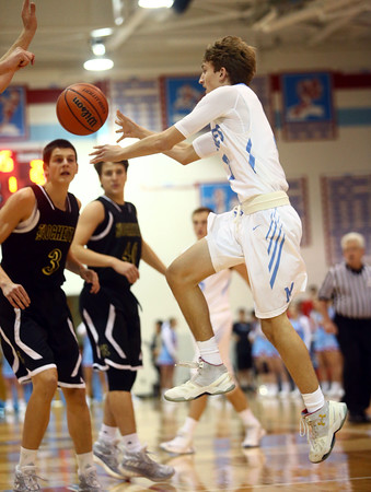 11-29-16<br /> Maconaquah boys basketball<br /> Chandler Pitts leaps to make a pass.<br /> Kelly Lafferty Gerber | Kokomo Tribune