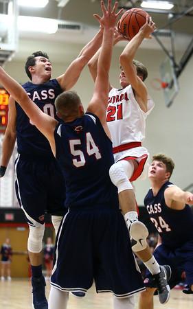 11-26-16<br /> Taylor vs Cass boys basketball<br /> Taylor's Gavin Cox shoots.<br /> Kelly Lafferty Gerber   Kokomo Tribune