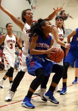 11-9-16<br /> Taylor vs Kokomo girls basketball<br /> Kokomo's Jayda Andrews looks to the basket.<br /> Kelly Lafferty Gerber | Kokomo Tribune