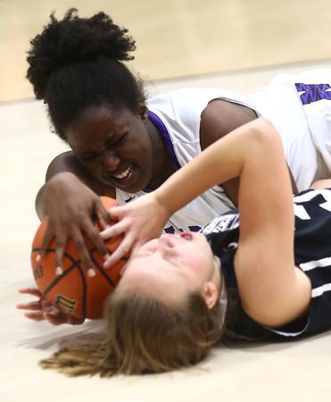 11-22-16<br /> Northwestern vs Western girls basketball<br /> NW's Beza Townsend grabs a loose ball.<br /> Kelly Lafferty Gerber | Kokomo Tribune