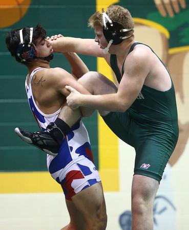 11-30-16<br /> Eastern vs Kokomo wrestling<br /> Eastern's Asher Walden and Kokomo's G. Herrera<br /> Kelly Lafferty Gerber | Kokomo Tribune