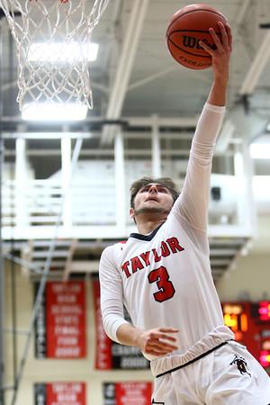 11-26-16<br /> Taylor vs Cass boys basketball<br /> Taylor Malin Vazquez makes a layup after he gets posession of a loose ball.<br /> Kelly Lafferty Gerber   Kokomo Tribune